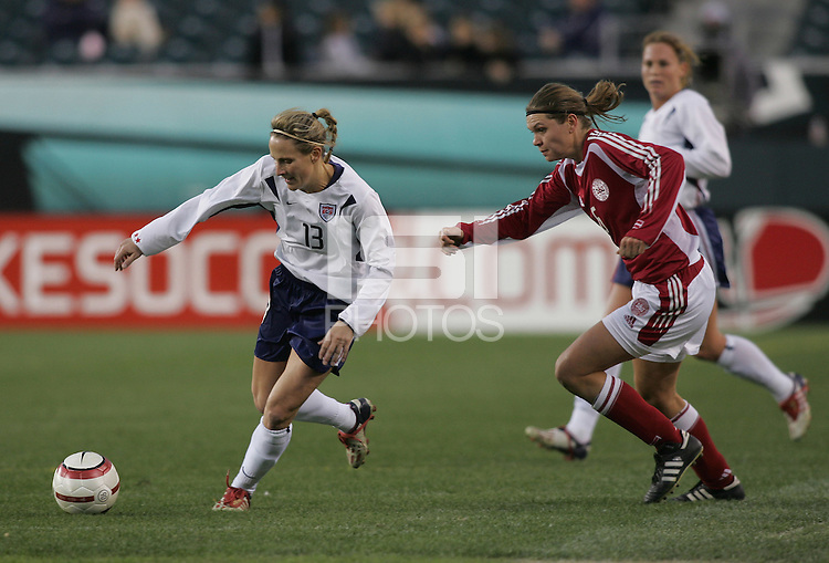 06 November,  2004.   Denmark's Louise Hansen (6) can't keep up with Kristine Lilly (13) of the USWNT at  Lincoln Financial Field in Philadelphia, Pa.