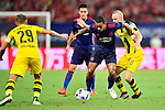 Manchester United winger Memphis Depay (c) dribbling Borussia Dortmund midfielder Sebastian Rode (r) during the International Champions Cup China 2016, match between Manchester United vs Borussia  Dortmund on 22 July 2016 held at the Shanghai Stadium in Shanghai, China. Photo by Marcio Machado / Power Sport Images