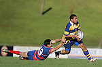 Mark Lawson gets taken for a slide as his attempts to tackle Seta Feloko. McNamara Cup final - Premier 1 Championship, Patumahoe v Ardmore Marist. Patumahoe won 13 - 6. Counties Manukau club rugby finals played at Growers Stadium, Pukekohe, 24th of June 2006.