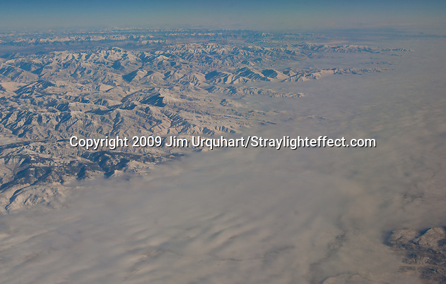 Jim Urquhart/Straylighteffect.com Aerial of snow-capped mountians and plains in western Idaho. Jim Urquhart/straylighteffect.com