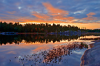 Clouds reflected in Grundy Lake at sunrise<br />