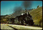 3/4 view of #497 double-headed with another K-37 on the relocated track near Navajo Lake.<br /> D&amp;RGW  Juanita, CO