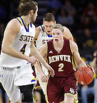 SIOUX FALLS, SD - MARCH 7:  Joe Rosga #2 of Denver dribbles the ball against defender Jake Bittle #4 of South Dakota State in the 2016 Summit League Tournament.   (Photo by Dick Carlson/Inertia)