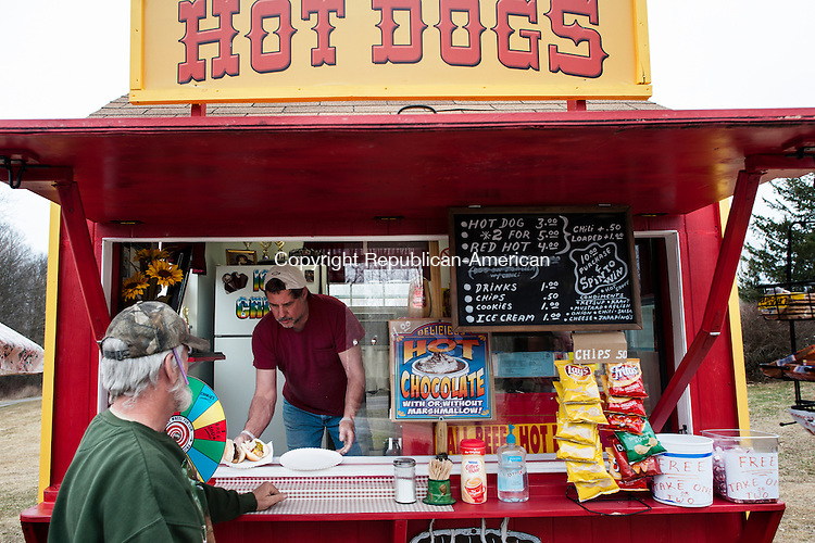HARWINTON, CT-7 April 2014-040714EC05-   Wild Art North. Paul Longo serves a customer while he runs the hot dog stand along Burlington Road/Route 4 in Harwinton Monday afternoon. Erin Covey Republican-American
