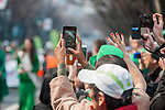 Onlookers wave and take photos during the 25th Annual St. Patrick's Day Parade on Sunday, March 19, 2017 in Tokyo, Japan.<br /> Photo by Kevin Clifford