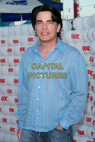 PETER GALLAGHER.Fox TCA Party, .Santa Monica, 29th July 2005.half length blue pink stripe shirt jeans.www.capitalpictures.com.sales@capitalpictures.com.© Capital Pictures.