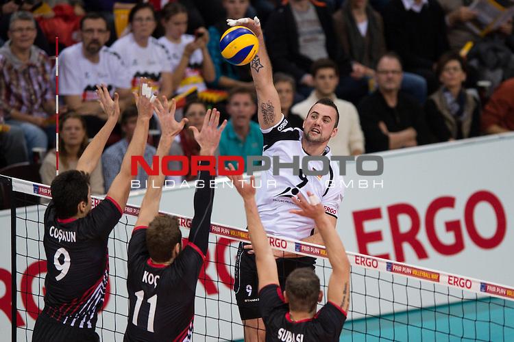 05.01.2014, MHP Arena, Ludwigsburg<br /> Volleyball, Qualifikation WM 2014, Deutschland vs. T&uuml;rkei / Tuerkei<br /> <br /> Block  / Dreierblock Serhat Coskun (#9 TUR), Mustafa Koc (#11 TUR), Burutay Subasi (#8 TUR) - Angriff Georg / Gy&ouml;rgy / Gyoergy Grozer (#9 GER)<br /> <br />   Foto &copy; nordphoto / Kurth