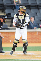 Wake Forest Demon Deacons catcher Ben Breazeale (9) on defense against the Maryland Terrapins at Wake Forest Baseball Park on April 4, 2014 in Winston-Salem, North Carolina.  The Demon Deacons defeated the Terrapins 6-4.  (Brian Westerholt/Four Seam Images)