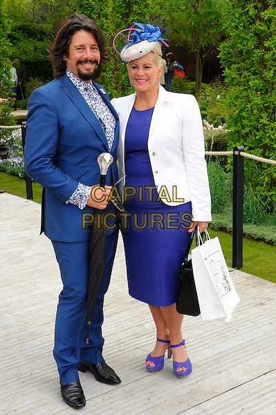 Laurence and Jackie Llewelyn Bowen.RHS Chelsea Flower Show Press and VIP Preview Day, Royal Hospital, Chelsea, London, England..May 20th 2013.full length blue suit dress blazer white hat married husband wife goatee facial hair .CAP/CJ.©Chris Joseph/Capital Pictures.