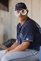 Matthew Morizio #24 of the Wilmington Blue Rocks wears a pair of glasses that he fashioned out of Styrafoam cups at Wake Forest Baseball Stadium August 5, 2009 in Winston-Salem, North Carolina. (Photo by Brian Westerholt / Four Seam Images)