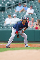 Mookie Betts (12) of the Pawtucket Red Sox takes his lead off of first base against the Charlotte Knights at BB&T Ballpark on August 8, 2014 in Charlotte, North Carolina.  The Red Sox defeated the Knights  11-8.  (Brian Westerholt/Four Seam Images)
