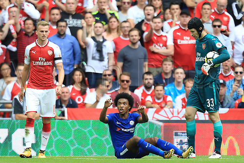August 6th 2017, Wembley Stadium, London, England; FA Community Shield Final, Arsenal versus Chelsea; Willian of Chelsea complains to the referee as he sees a yellow card for diving