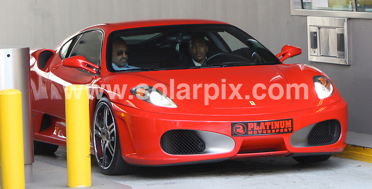 **ALL ROUND PICTURES FROM SOLARPIX.COM**.**WORLDWIDE SYNDICATION RIGHTS EXCEPT FOR USA, AUSTRALIA & GERMANY**.Hollywood actor Rapper & Comedian Nick Cannon shows off his new ride a red Ferrari with his friend as he gets some cash at the bank in Beverly Hills, CA..JOB REF: 7513      LAS       DATE:02.10.08.**MUST CREDIT SOLARPIX.COM OR DOUBLE FEE WILL BE CHARGED* *UNDER NO CIRCUMSTANCES IS THIS IMAGE TO BE REPRODUCED FOR ANY ONLINE EDITION WITHOUT PRIOR PERMISSION*