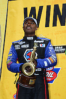 Jul, 22, 2012; Morrison, CO, USA: NHRA top fuel dragster driver Antron Brown celebrates after winning the Mile High Nationals at Bandimere Speedway. Mandatory Credit: Mark J. Rebilas-