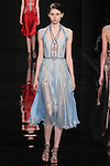 "Model walks runway in a powder blue iridescent chiffon dress with lace underlay and embroidered detail from the Reem Acra Fall 2016 ""The Secret World of The Femme Fatale"" collection, at NYFW: The Shows Fall 2016, during New York Fashion Week Fall 2016."