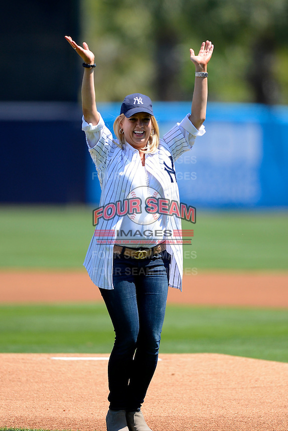 New York Yankees guest Pam Bondi, Attorney General of Florida, throws out a ceremonial fist pitch before a Spring Training game against the Pittsburgh Pirates at Legends Field on March 28, 2013 in Tampa, Florida.  (Mike Janes/Four Seam Images)