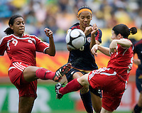 USWNT forward (6) Natasha Kai has the ball cleared away from her by Canada's (9) Candace Chapman and (8) Diana Matheson during the finals of the Peace Queen Cup.  The USWNT defeated Canada, 1-0, at Suwon World Cup Stadium in Suwon, South Korea.