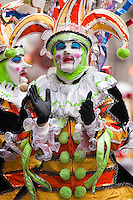 A mummer claps as his brigade marches north on Broad Street in the Philadelphia Mummer's Parade on New Year's Day 2006.