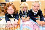 Scoil Naomh Eirc Junior Infants pupils Aisling Ní Chinnéide, Hanna Ní Gearailt and Eabha Ní Chinnéide enjoying their first day at school.