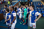 Home players waiting for fans to be cleared from the pitch after an invasion by Blackburn supporters as Blackburn Rovers take on Oxford United in a Sky Bet EFL League One fixture at Ewood Park, Blackburn. The home side had already achieved promotion back to the Championship after one season down in League One. The match ended in a 2-1 victory for the home side, watched by 27,600 spectators which confirmed Blackburn as runners-up in League One.