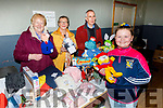Niamh Murphy from Ballymac has her eyes on teddy at the Ballymac Bazaar in the community centre on Sunday with John Belfry, Shiela Barnes and Doireann Butler.