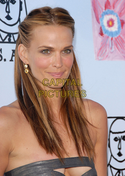 MOLLY SIMS.Attends Los Angeles Antiques Show Preview Party held at Barker Hangar in Santa Monica, California, USA..April 25th, 2007.headshot portrait strapless silver cut out away cleavage .CAP/DVS.©Debbie VanStory/Capital Pictures