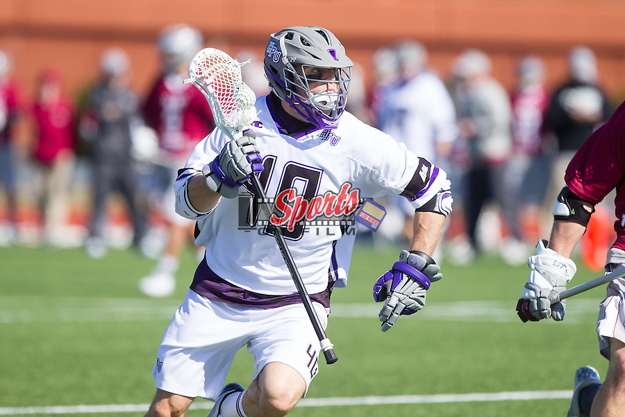 Bucky Smith (40) of the High Point Panthers on the attack against the St. Joseph's Hawks at Vert Track, Soccer & Lacrosse Stadium on February 16, 2014 in High Point, North Carolina.  The Panthers defeated the Hawks 9-7.   (Brian Westerholt/Sports On Film)