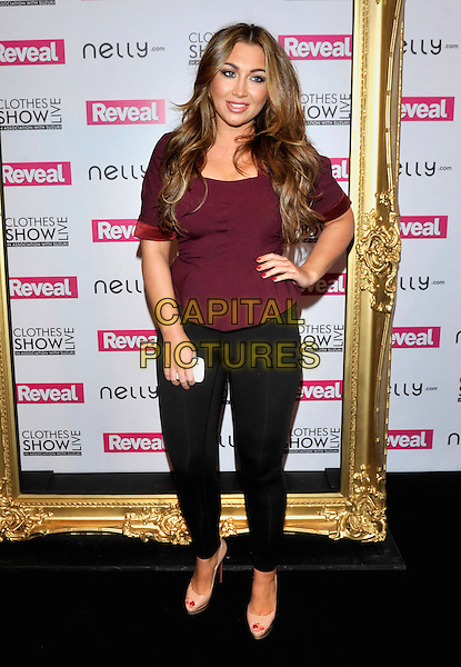 Lauren Goodger.At the Clothes Show Live 2012 at the NEC Birmingham, England..December 9th 2012.full length maroon burgundy top black leggings hand on hip nude shoes .CAP/JIL.©Jill Mayhew/Capital Pictures