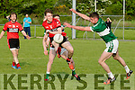 Shoot<br /> --------<br /> Gavin Breen, Tarbert has his shot blocked by Billy Bryan, Listry when the sides met last Saturday evening in Listry.