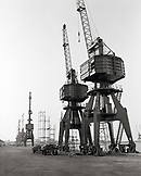 ERITREA, Massawa, cranes line the Port of Massawa at the edge of the Red Sea (B&W)