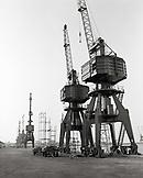 ERITREA, Massawa, cranes line the Port of Massawa at the edge of the Red Sea (B&W)