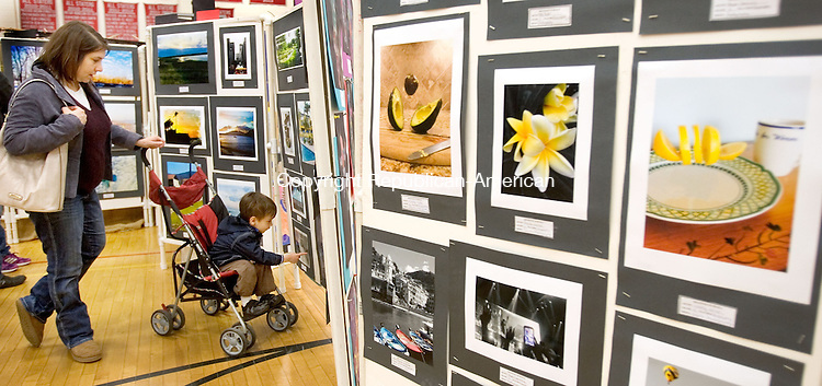 (COUNTRYLIFE USE ONLY)<br /> SOUTHBURY CT. 26 April 2014-042617SV15-Michele Christian and hers son Roman, 3, of Southbury check out some of the artwork during the Region 15 art show at Pomperaug High in Southbury Saturday.<br /> Steven Valenti Republican-American