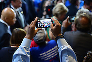 Baltimore, MD - April 10, 2016: A man takes a cell phone picture as former Secretary of State and 2016 Democratic presidential candidate Hilary Clinton greets supporters with Rep. Elijah Cummings during a campaign event at the City Garage in Baltimore, MD, April 10, 2016.  (Photo by Don Baxter/Media Images International)