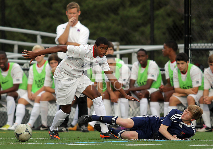HYATTSVILLE, MD - OCTOBER 26, 2012:  Julian Dove (17) of DeMatha Catholic High School  loses the ball to a tackle by Nate Johnson (19) of St. Albans during a match at Heurich Field in Hyattsville, MD. on October 26. DeMatha won 2-0.