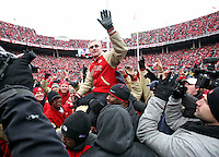 Former Buckeye coach Jim Tressel is carried by members of the 2002 team after being introduced on the 10th anniversary of their championship season at Ohio Stadium on November 24, 2012.  (Chris Russell/The Columbus Dispatch)