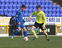 Ryan Christie being closed down by Jason Naismith in the Inverness Caledonian Thistle v St Mirren Scottish Professional Football League Premiership match played at the Tulloch Caledonian Stadium, Inverness on 29.3.14.