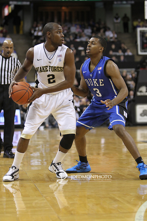 Wake Forest Demon Deacons guard Gary Clark (2) looks for the outlet as Duke Blue Devils guard Tyler Thornton (3) applies pressure. Duke leads at halftime 41-32.