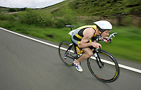 05 JUN 2005 - BALA, NORTH WALES, UK - Stephen Bayliss gets down low on the crossbar to cut wind resistance on a downhill stretch during the British Middle Distance Triathlon .Championships 2005. (PHOTO (C) NIGEL FARROW)