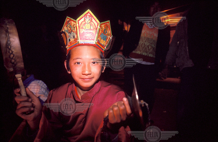 The Naxi, an ethnic minority numbering 280,000 people in Yunnan and Sichuan provinces, practice the ancient shamanistic religion of Dongba. Young shaman Yang Ji Hui at camp fire.