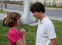 Liberal Party of Canada leader Justin Trudeau chats with Lisette Blanchet-Noreau at the Festival de Musique Militaire in Quebec City, Wednesday August 21, 2013.<br /> <br /> PHOTO :  Francis Vachon - Agence Quebec Presse
