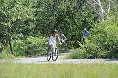 First lady Michelle Obama bike riding during their vacation in West Tisbury on Martha's Vineyard, Massachusetts on August 16, 2013.  <br /> Credit: Rick Friedman / Pool via CNP