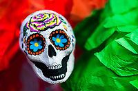 A painted scull made of paper is placed on an altar created in Mexican flag colors, situated on Plaza de Santo Domingo in Mexico City, Mexico, 28 October 2016. Skulls, skeletons and the other death symbols are used to adorn graves, altars and offerings during the Day of the Dead (Día de Muertos). A syncretic religious holiday, combining the death veneration rituals of the ancient Aztec culture with the Catholic practice, is celebrated throughout all Mexico. Based on the belief that the souls of the departed may come back to this world on that day, people gather at the gravesites in cemeteries, praying, drinking and playing music, to joyfully remember friends or family members who have died and to support their souls on the spiritual journey.