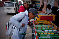 .School children playing table soccer.Just 25 years ago it was a small group of houses around La Paz  airport, at an altitude of 12,000 feet. Now El Alto city  has  nearly one million people, surpassing even the capital of Bolivia, and it is the city of Latin America that grew faster .<br /> 	It is also a paradigmatic city of the troubles  and traumas of the country. There got refugee thousands of miners that lost  their jobs in 90 &acute;s after the privatization and closure of many mines. The peasants expelled by the lack of land or low prices for their production. Also many who did not want to live in regions where coca  growers and the Army  faced with violence.<br /> 	In short, anyone who did not have anything at all and was looking for a place to survive ended up in El Alto.<br /> 	Today is an amazing city. Not only for its size. Also by showing how its inhabitants,the poorest of the poor in one of the poorest countries in Latin America, managed to get into society, to get some economic development, to replace their firs  cardboard houses with  new ones made with bricks ,  to trace its streets,  to raise their clubs, churches and schools for their children.<br /> 	Better or worse, some have managed to become a sort of middle class, a section of the society that sociologists call  emerging sectors. Many, maybe  most of them, remain for statistics as  poor. But clearly  all of them have the feeling they got  for their children a better life than the one they had to face themselves .
