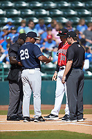 Charleston RiverDogs manager Julio Mosquera (29) meets with Hickory Crawdads manager Matt Hagan (39) and umpires James Jean (left) and Colin Baron (right) prior to the South Atlantic League game at L.P. Frans Stadium on May 13, 2019 in Hickory, North Carolina. The Crawdads defeated the RiverDogs 7-5. (Brian Westerholt/Four Seam Images)