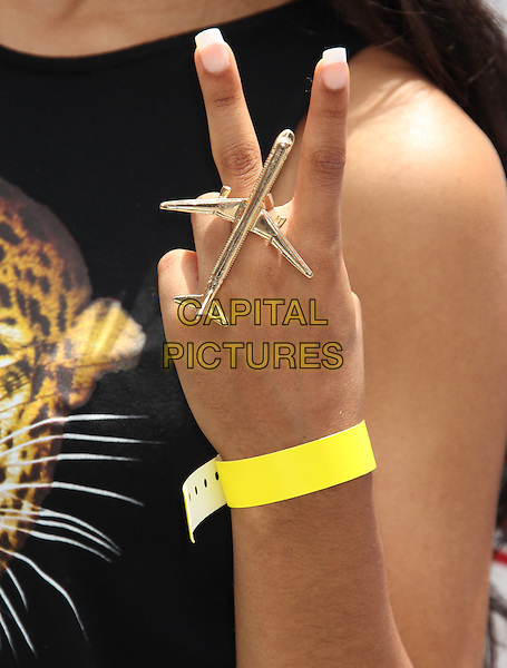 Jessica Jarrell's hand<br /> 7th Annual Kidstock Music and Art Festival held at Greystone Mansion, Beverly Hills, California, USA.<br /> June 2nd, 2013<br /> detail plane ring silver jewellery jewelry hand v peace yellow yellow bracelet <br /> CAP/ADM/RE<br /> &copy;Russ Elliot/AdMedia/Capital Pictures
