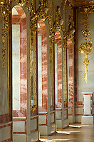 The work of master gilder Johann Endres frames the windows and marble panelling of the walls of the throne room