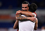 Calcio, Serie A: AS Roma vs Torino. Roma, stadio Olimpico, 19 novembre 2012..AS Roma midfielder Miralem Pjanic, of Bosnia, back to camera, is hugged by teammate Pablo Daniel Osvaldo after scoring during the Italian Serie A football match between AS Roma and Torino at Rome's Olympic stadium, 19 November 2012..UPDATE IMAGES PRESS/Isabella Bonotto