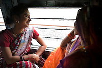 L-R.Rani Lakhera and her sister-in-law, Sulochna Lakhera aged 32, laugh and chat while passing from Madhya Pradesh to Maharashtra on 8th July 2009, where the weather was much cooler compared to the northern states...Train passengers on the Himsagar Express 6318 going from Jammu Tawi station to Kanyakumari on 8th July 2009.. .6318 / Himsagar Express, India's longest single train journey, spanning 3720 kms, going from the mountains (Hima) to the seas (Sagar), from Jammu and Kashmir state of the Indian Himalayas to Kanyakumari, which is the southern most tip of India...Photo by Suzanne Lee / for The National
