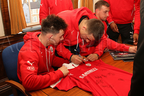 07.04.2016. Barnsley, England. Barnsley FC Johnstones Paint Trophy winners celebrations and parade. Barnsley players sign autographs on replica shirts