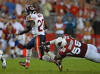 Oct. 16, 2006; Glendale, AZ, USA; Chicago Bears running back (20) Thomas Jones evades a diving Arizona Cardinals linebacker (58) Karlos Dansby at University of Phoenix Stadium in Glendale, AZ. Mandatory Credit: Mark J. Rebilas